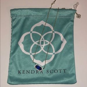 royal blue kendra scott with gold chain